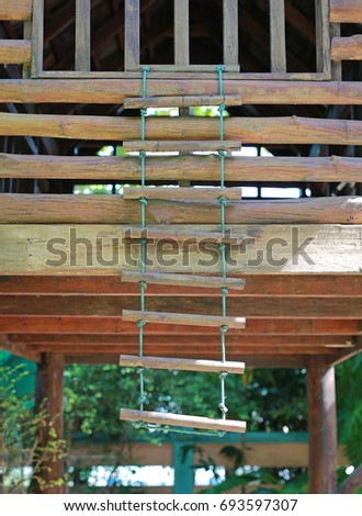 Rope wooden ladder at playground