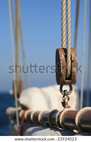 Ropes and other stuff of an old sail boat - stock photo