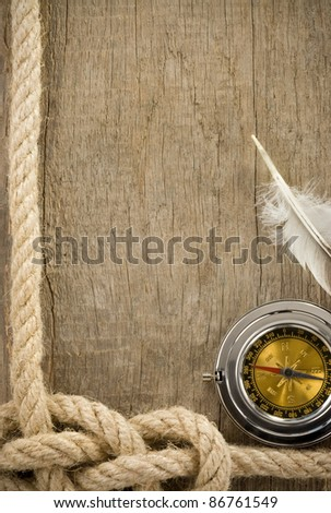 ropes and sea compass on wood texture background