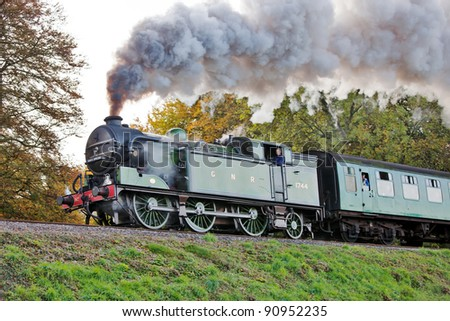 ROPLEY, ENGLAND - OCTOBER 29: Guest loco GNR 1744 passes into Wanderers curve with a passenger train at the Mid Hants Railway autumn steam gala on October 29, 2011 at Ropley - stock photo
