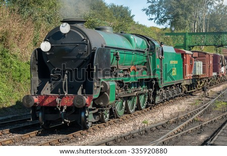ROPLEY, UK - 19 SEPTEMBER: The Lord Nelson 850 vintage steam locomotive arriving at the Mid-Hants Watercress railway station of Ropley, UK on 19 September, 2015 - stock photo