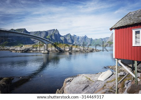 Rorbuer, fisherman house on stilts in Lofoten archipelago and bridge on Moskenesoya island. Norway.