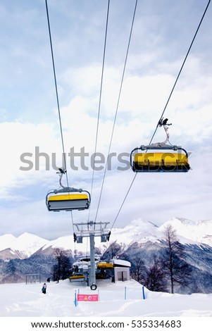 Rosa Khutor, Russia - December 8, 2016: ski lift chairs on Rosa ski peak