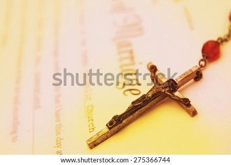 Rosary beads on wedding certificate