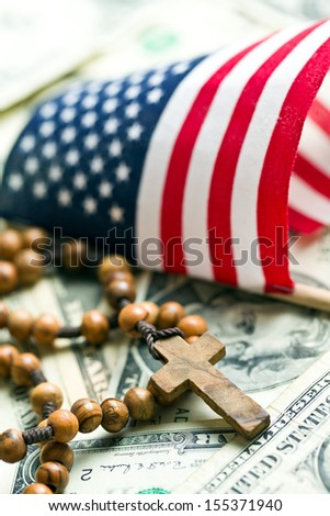 rosary beads with american flag on us dollars background - stock photo