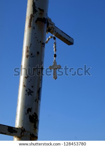 Rosary hanging from the top of Krizevac confidence close to the apparitions of Our Lady of the wheel Mdjugorje in Bosnia and Herzegovina - stock photo