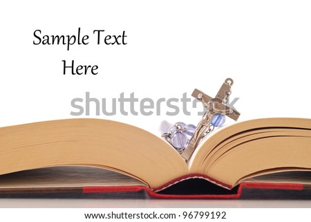 Rosary on Bible - stock photo