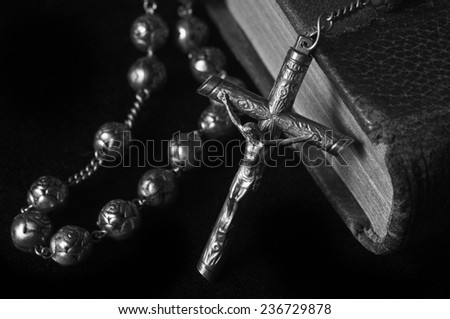 Rosary on The Bible - stock photo