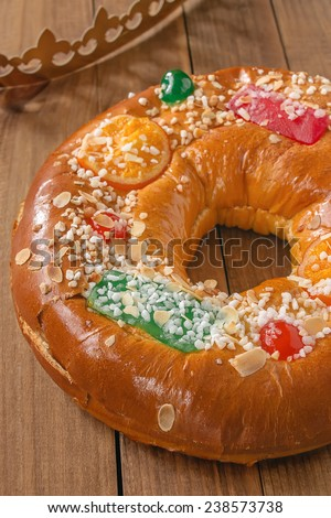 "Roscon de reyes (Three kings cake). It is a traditional Spanish holiday dessert served the morning of ""?Reyes"" (King's Day), or Epiphany (January 6th) - stock photo"