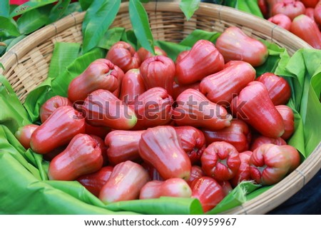 rose apple in basket, rose apple on green leave in basket. tropical fruit ,market in Thailand
