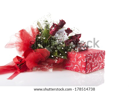 rose bouquet and gift on white