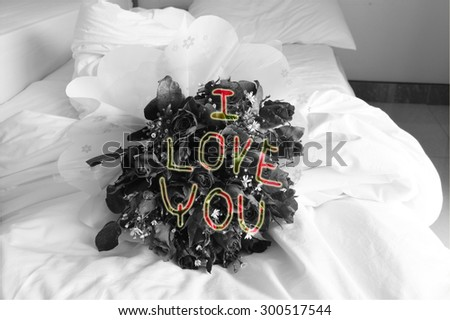 rose bouquet on black and white tone and i love you sign - stock photo