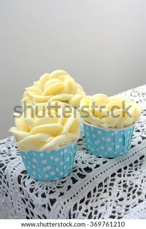 Rose butter cream flower cupcakes  - stock photo