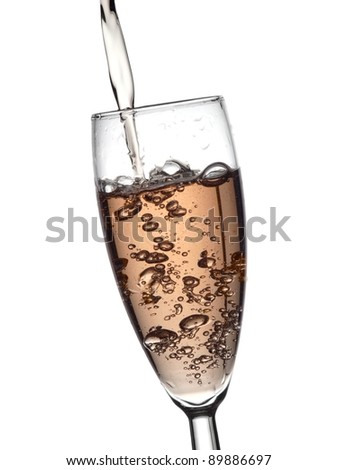 Rose champagne pour in a glass