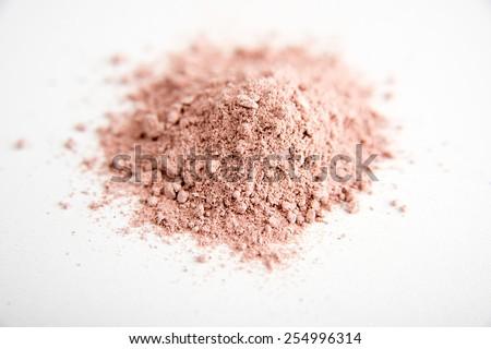 Rose Clay Mask Powder on White Background - stock photo