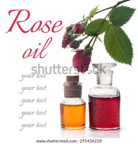 Rose essential oil, rose flowers on a white background. Spa, aromatherapy and body care