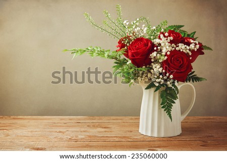 Rose flower bouquet on wooden table with copy space - stock photo