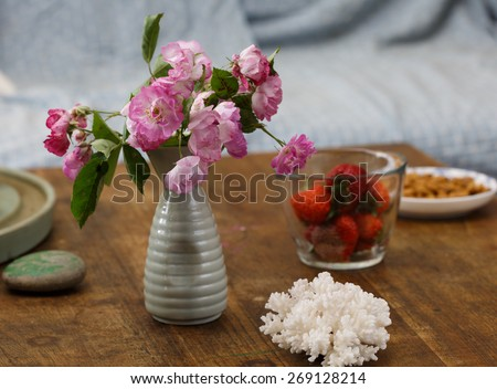 Rose flowers and food on the table. - stock photo
