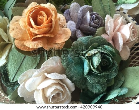 Rose flowers in mulberry paper texture with lighting at morning - stock photo