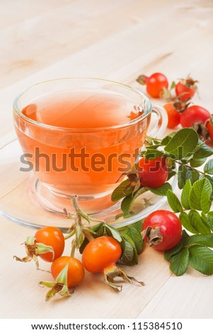 rose hip tea and red berries - stock photo