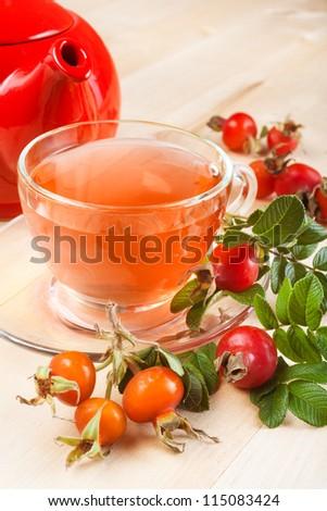 rose hip tea and red teapot - stock photo