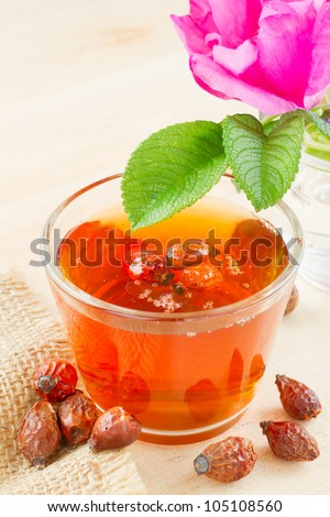 rose hips tea and rose-hip flowers - stock photo