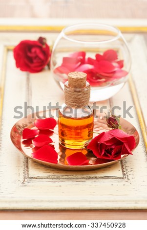 Rose oil and rose petals. Spa - stock photo