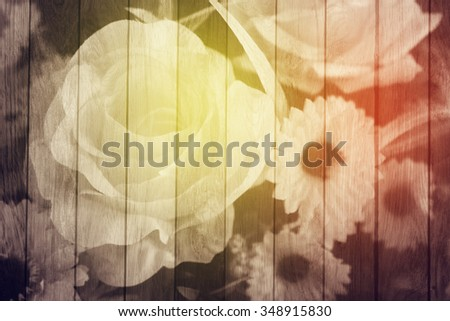 rose on surface of wooden floor background