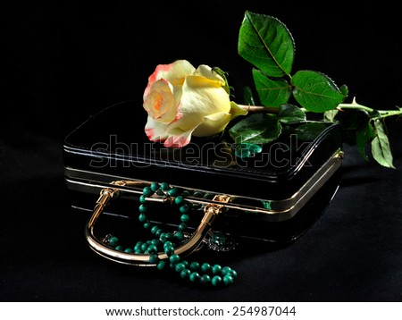 Rose on the bag with malachite - stock photo