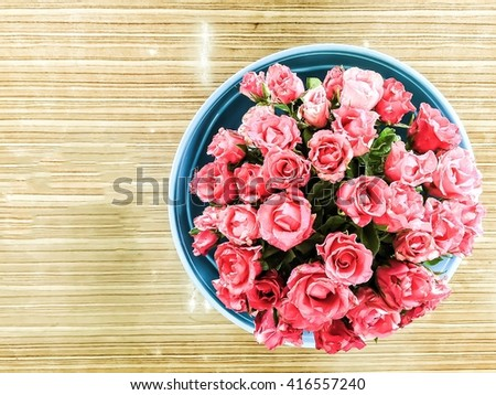 Rose over wood background. : Flowers on wooden background : soft focus. :focus on wood table on left hand not flower - stock photo