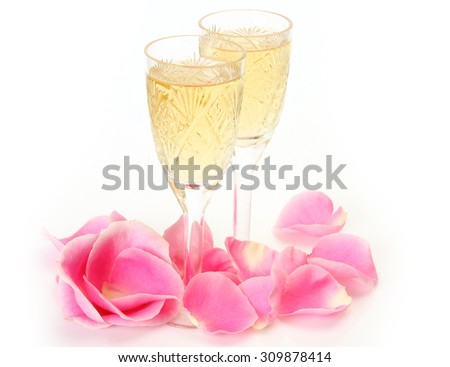 rose petals and champagne - stock photo