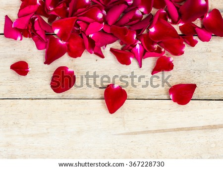 Rose Petals Border on a wooden table
