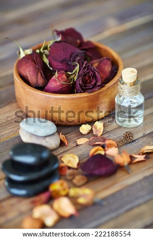 Rose petals, oil and pebble for health spa - stock photo
