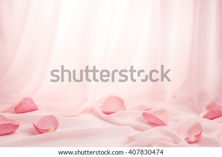 Rose petals on soft silk - stock photo