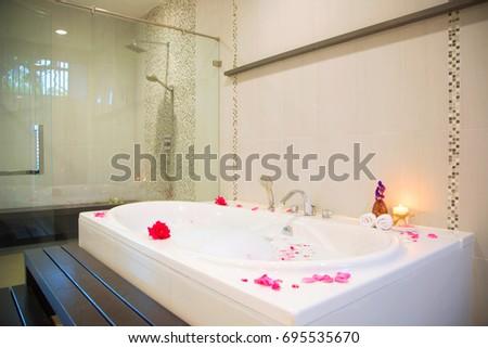 Rose Petals Put In Bathtub For Romantic Bathroom In Honeymoon Suit Arranged  By Interior Designer Served