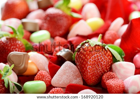 rose petals, strawberry and candy  - stock photo