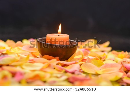 rose petals with candle in wooden bowl  - stock photo