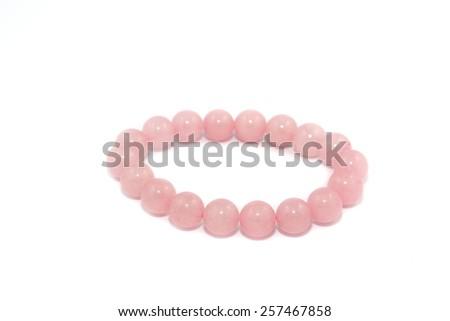 Rose quarts on white background - stock photo