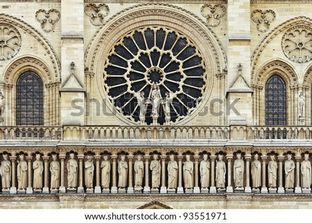 Rose shapes window in the front of the Gothic Notre Dame cathedral, Paris - stock photo