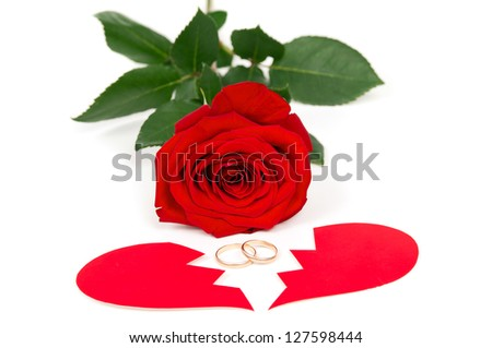 rose wedding rings and the two halves of heart - stock photo