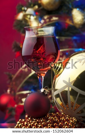 rose wine and Christmas decoration against color background