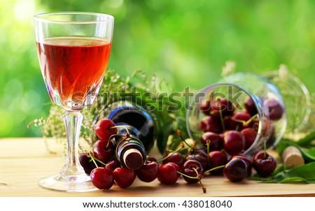 Rose wine and red cherries - stock photo