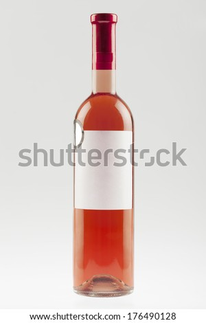 Rose wine bottle with empty label - stock photo