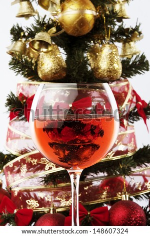 rose wine glass and Christmas decoration light background