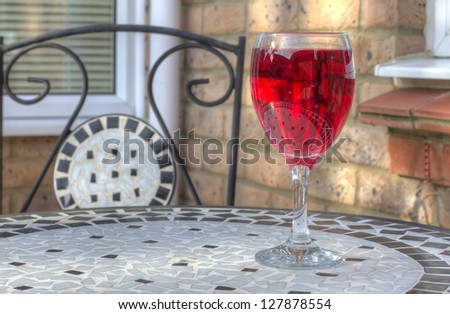 Rose wine on an outdoor table in the summer - stock photo