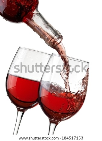 Rose wine pouring in two glasses