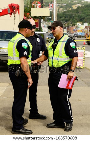 ROSEBURG, OR - JULY 20: Police working a four vehicle accident involving two large trucks resulted in a single injury and a diesel fuel spill. July 20, 2012 in Roseburg Oregon - stock photo