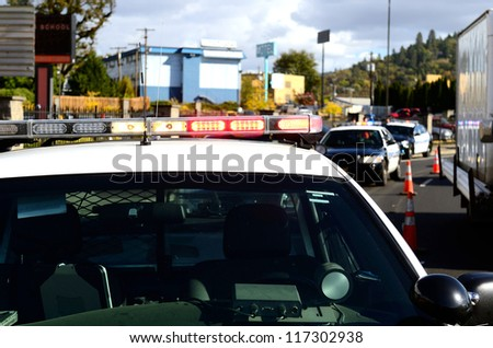 ROSEBURG, OR - OCTOBER 16: Police cars at an accident at the entrance of the High School loading zone in Roseburg Oregon, October 16, 2012