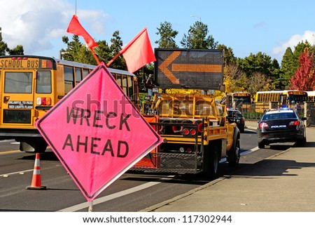 ROSEBURG, OR - OCTOBER 16:Traffic control at a truck rollover accident at the entrance to Interstate 5 causes backup in Roseburg Oregon, October 16, 2012 - stock photo