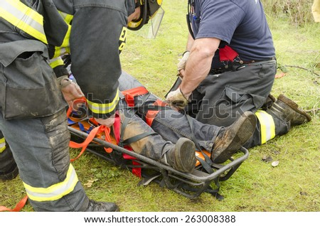 Roseburg, OR, USA - December 5, 2014: Douglas County Fire District #2 conducting a low angle rope rescue of a car crash victim